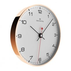 Side view photo of rose copper wall clock with black numbers and hands
