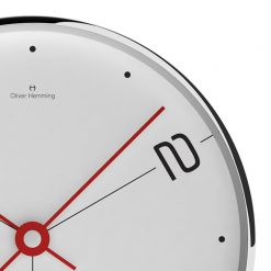 Photo of contemporary white face wall clock with black numbers and red hands