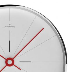 Close-up photo of white face wall clock with silver outer rim and red hands