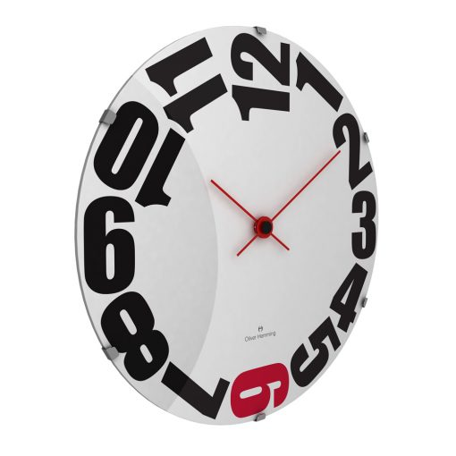 Sideview photo of large wall clock with large black numbers and red hands