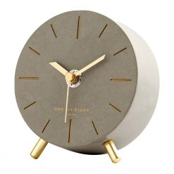 Perspective view of brown silent mantel clock with gold hands