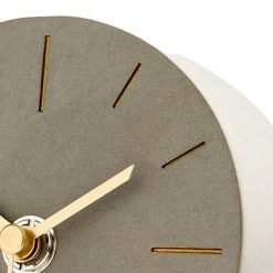 Close up image of round silent mantel clock with brown face and gold hands