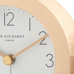 Close up image of champagne gold coloured silent alarm clock