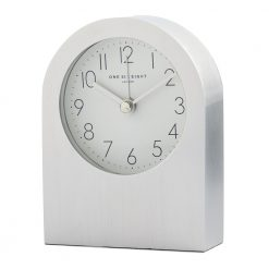 Front image of silver silent alarm clock with grey numbers