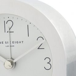 Close up photo of silent alarm clock with dark grey numbers