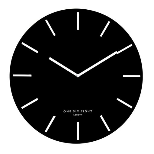 Image of large wall clock with black face and white markers and hands