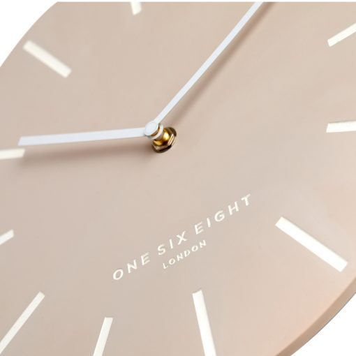 Blush coloured silent wall clock with white hands