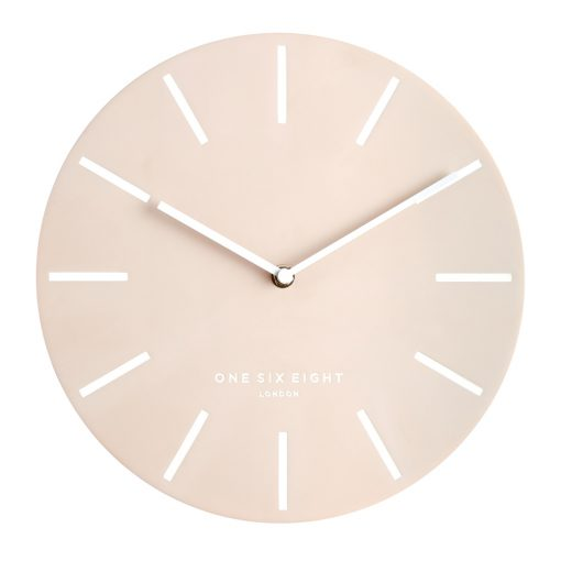 Front view photo of large wall clock with blush coloured face and white markers