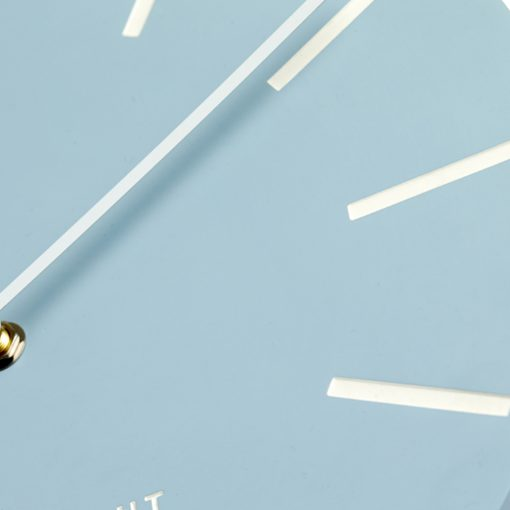 Close up photo of large blue wall clock with white hands and silent tick