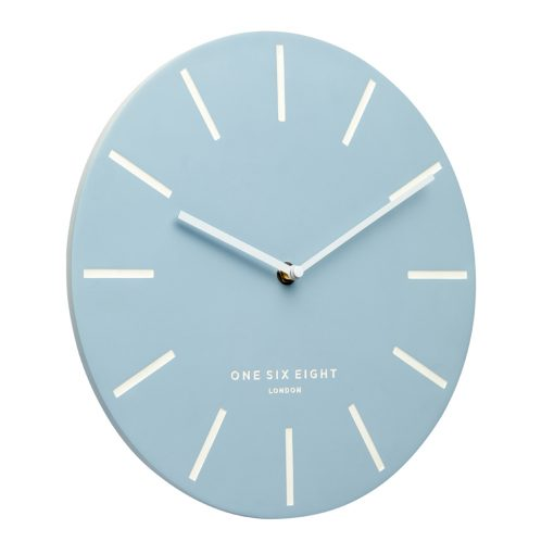 Side view full photo of large powder blue silent wall clock with white markers
