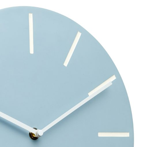 Close up photo of large pastel blue silent wall clock and white markers