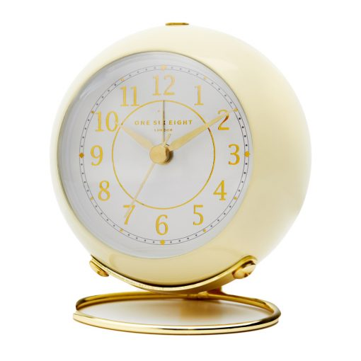 Photo of cream coloured silent tick alarm clock with gold numbers