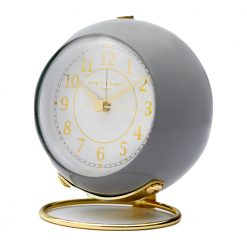 Close up photo of grey coloured alarm clock with gold numbers