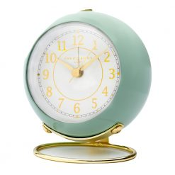 Silent alarm clock with sage green outer case and gold numbers