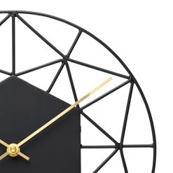 Close up photo of modern black wall clock with gold hands