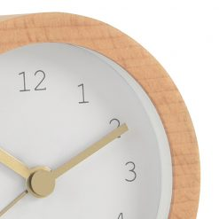 Close up photo of white alarm clock with wooden coloured case