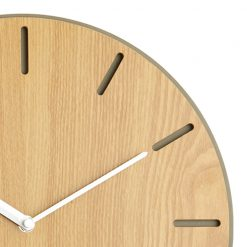 Close up photo of wooden wall clock with white hands