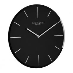 Side view photo of black glass wall clock with markers
