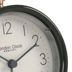 Close up photo cool grey alarm clock with hoop and white face