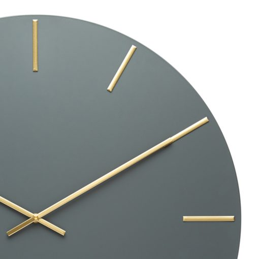 Close up image of dark grey silent wall clock with gold hands and numbers