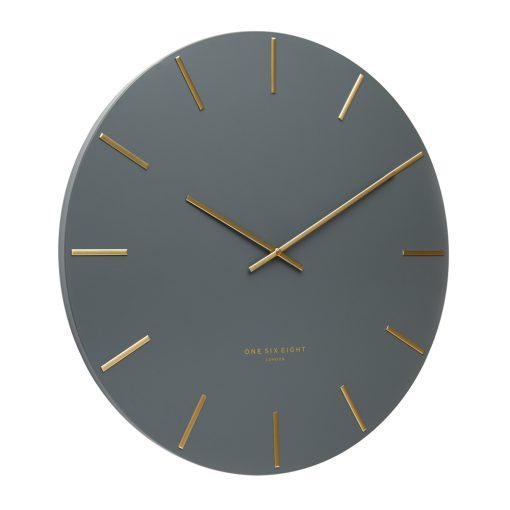 Angled view photo of large silent dark grey wall clock with gold hands