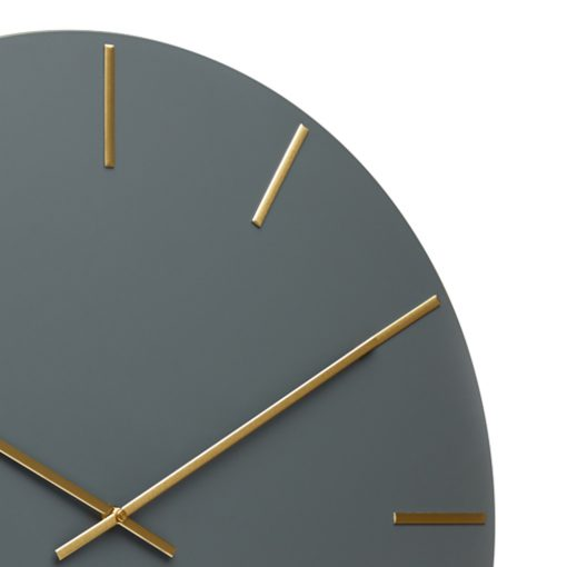 Close up photo of large charcoal wall clock and gold numbers and hands