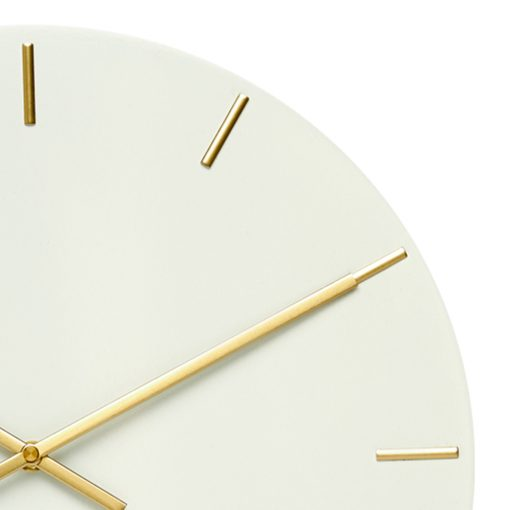 Close up photo of large white silent wall clock with gold markers