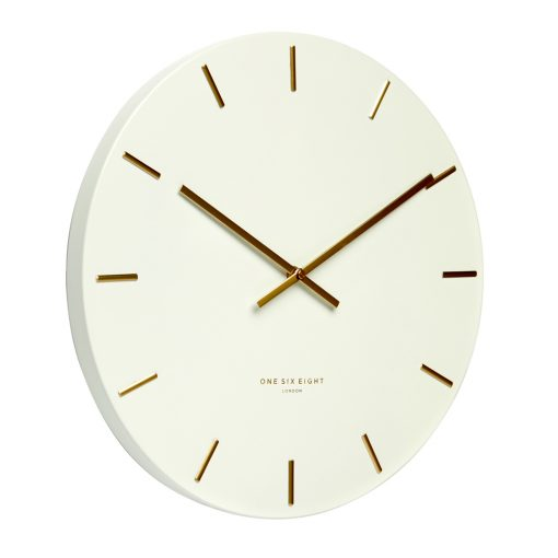 Side view photo of white wall clock with gold hands and markers