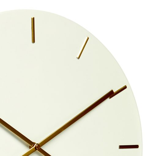 Close up image of white silent tick wall clock with gold markers