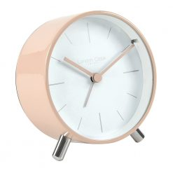 Angled view of blush alarm clock and white face