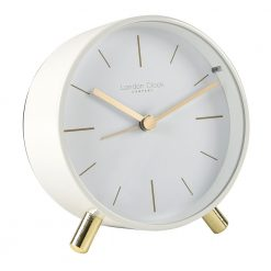 Angled view of pure white alarm clock and gold hands