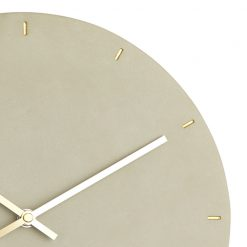 Close up photo of silent wall clock with concrete coloured face