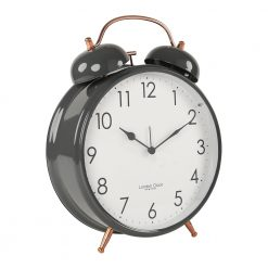 Photo of large grey alarm clock with white face