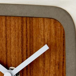 Close up photo of silent mantel clock with wooden face