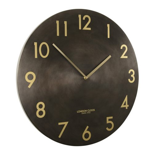 Side view photo of large gun metal clock with bronze numbers and hands