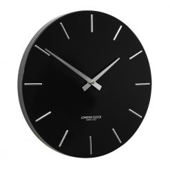 Full side view photo of black wall clock with metal hands