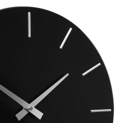 Close up photo fo black wall clock with metal grey hands and markers