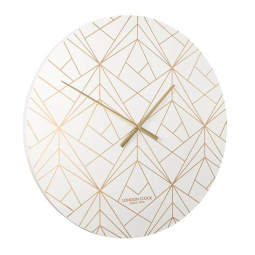 Angled view of large white modern wall clock with gold abstract lines