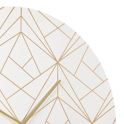 Close up photo of white metal wall clock with gold lines and hands