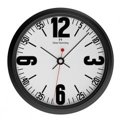 Photo of simple large black chrome steel wall clock with white face and bold numbers
