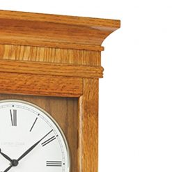 Close up photo of large wooden pendulum wall clock