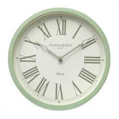 Image of sage green wall clock with roman numerals and white face