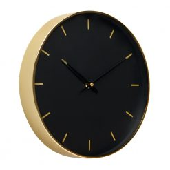 Angled photo of black and gold wall clock with markers