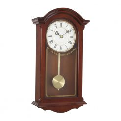 Photo of mahogany wood finish pendulum clock with roman numerals and white face