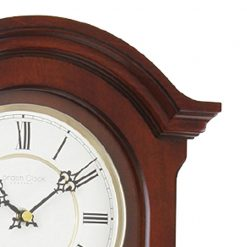 Close up photo of mahogany wooden clock pendulum wall clock with roman numerals
